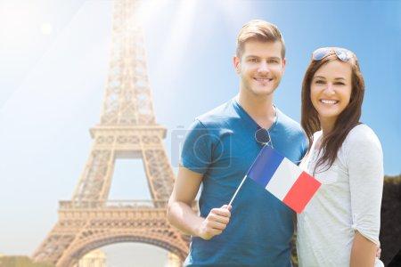 Happy Couple Holding French Flag