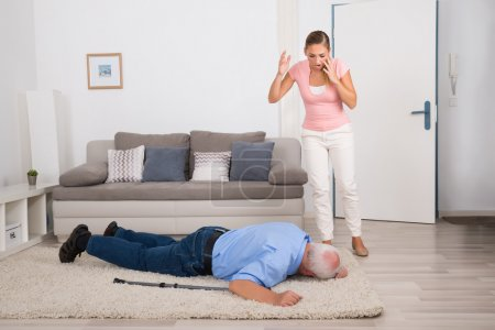 woman looking at her fainted disabled