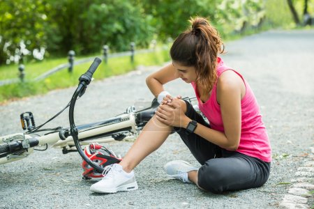 Young Woman With Pain In Knee When Fallen Down Fro...
