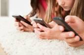 Family Using Smart Phones