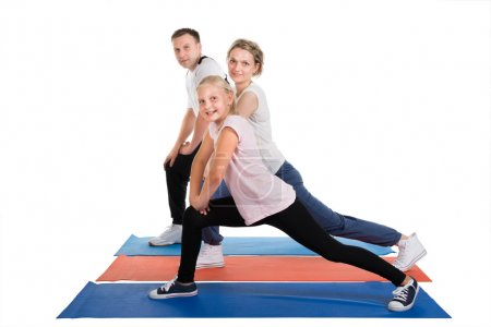 Young Family Doing Stretching Exercises