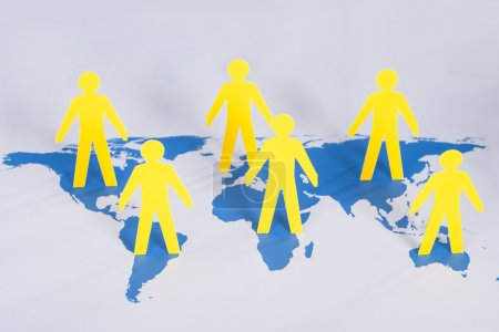 Photo for Social Network Concept. Paper people on world map - Royalty Free Image