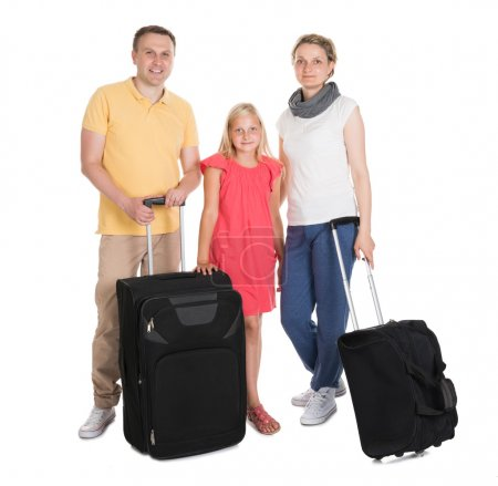 Photo for Young Family Standing With Luggage. Isolated On White - Royalty Free Image