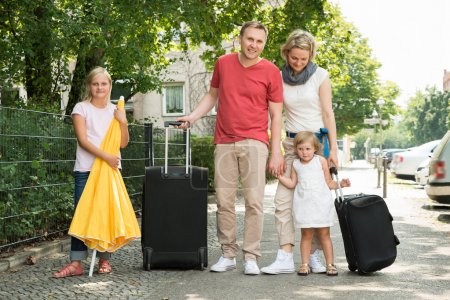 Happy Young Family Going On Vacation