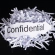 Shredded paper in data confidentiality concept ove...