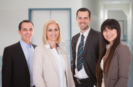 Photo for Portrait of confident business team smiling together in office - Royalty Free Image
