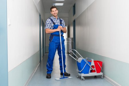 Male Worker With Broom