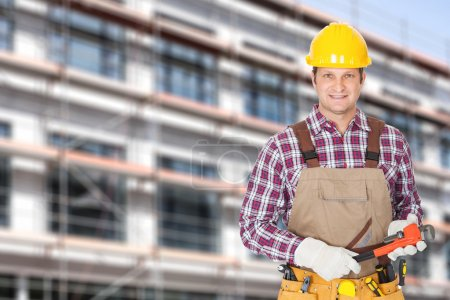 Photo for Portrait of mid adult architect holding adjustable wrench against building - Royalty Free Image
