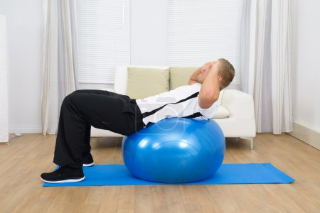 Man Leaning On Pilates Ball