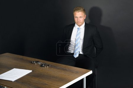 Businessman In Interrogation Room