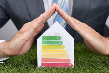 Businessman Shielding Energy Consumption Label