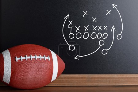 Football Play Strategy On Chalk Board