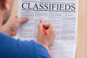 Man Looking In Classifieds For Job