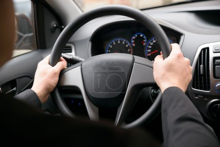 Photo for Close-up Of A Man Hands Holding Steering Wheel While Driving Car - Royalty Free Image