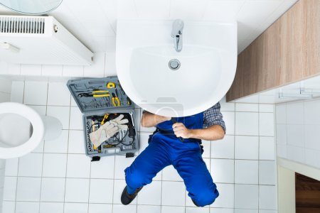 Plumber Repairing Sink