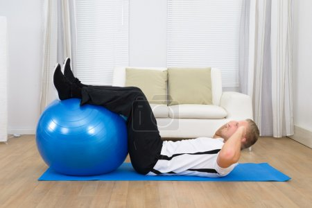 Man Doing Exercise With Ball