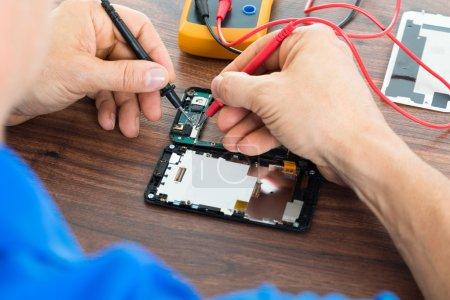 Technician Repairing Cellphone
