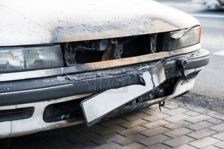 Photo for Close-up Of Damaged Rusty Car On Street - Royalty Free Image