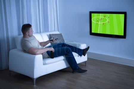 Man Watching Soccer Game