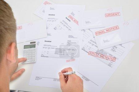 Man Calculating Financial Bills
