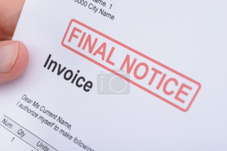 Man Holding Invoice With Final Notice Stamp...
