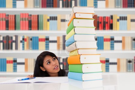 Woman Looking on Books