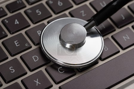 Medical Stethoscope On Laptop