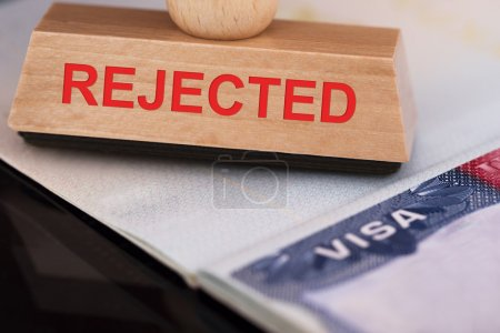 Photo for Close-up Photo Of Rejected wooden Stamp On Visa - Royalty Free Image