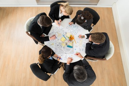 Businesspeople Discussing At Meeting