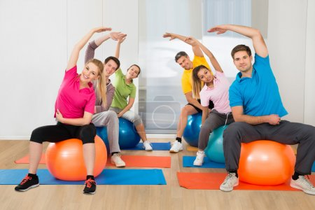 People Sitting On Pilates Balls
