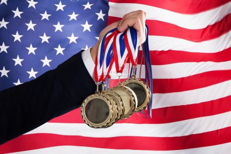 Businessman Holding Medals