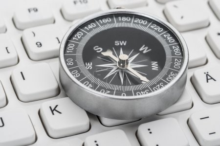 Photo for Close-up Photo Of Compass On Computer Keyboard - Royalty Free Image