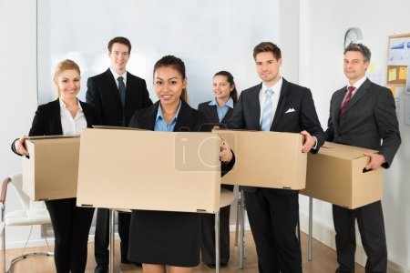 Employees Holding Cardboard Boxes