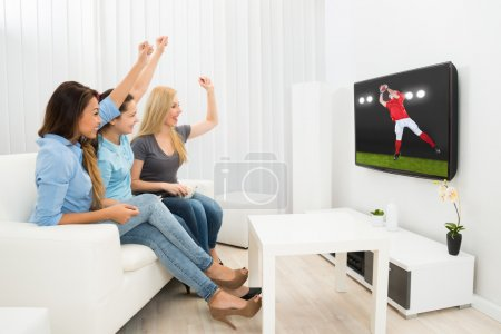 Women Watching Rugby Match
