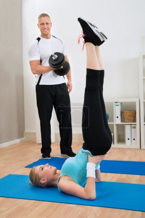 Couple Exercising At Home