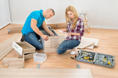 Couple Assembling Furniture