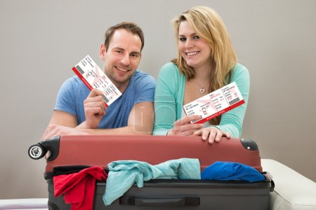 Couple Holding Boarding passes