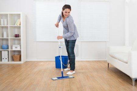 Woman Cleaning Hardwood Floor