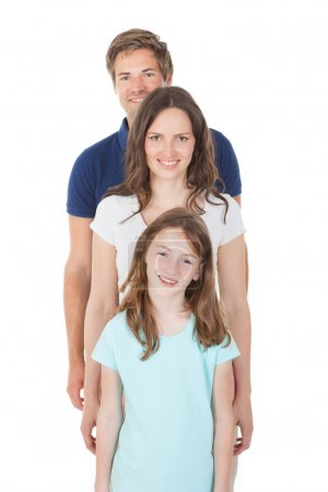 Photo for Full length portrait of family standing in line isolated over white background - Royalty Free Image