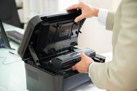 Businessman Fixing Cartridge