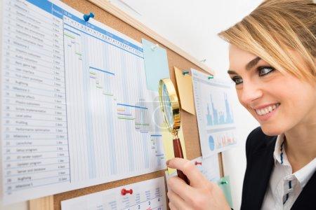 Businesswoman Examining Gantt Chart