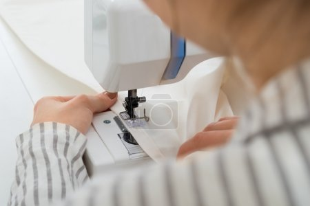 Woman Stitching Fabric