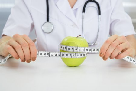 Dietician Measuring Green Apple