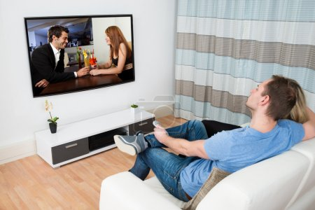 Couple Watching Movie On Television