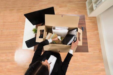 Businesswoman Packing Personal Belonging