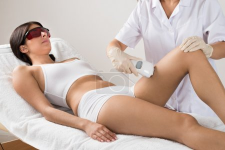 Beautician Giving Laser Therapy