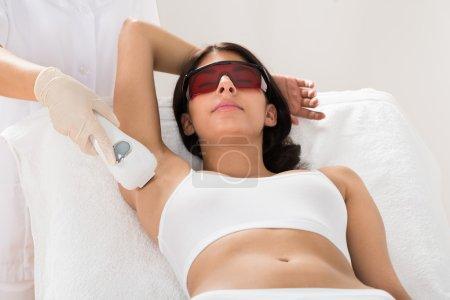 Woman Receiving Epilation Laser Treatment