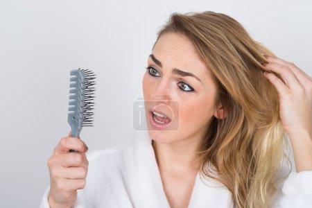 Woman Looking At Comb