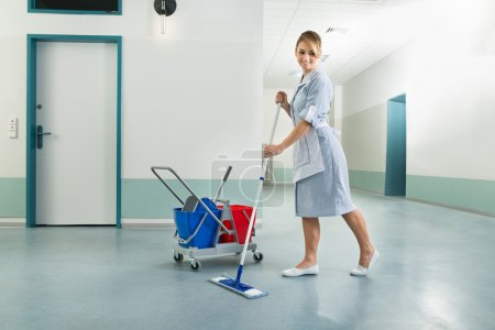 Happy Female Janitor Holding Mop