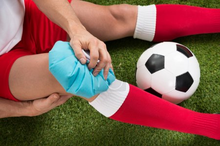 Soccer Player Icing Knee